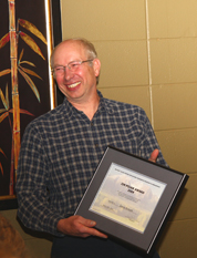 Jim Schwab accepting Jim Pojar Award